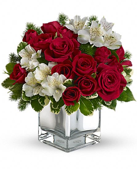 modern little Christmas with red roses and white alstroemeria in a charmingly contemporary silver cube.